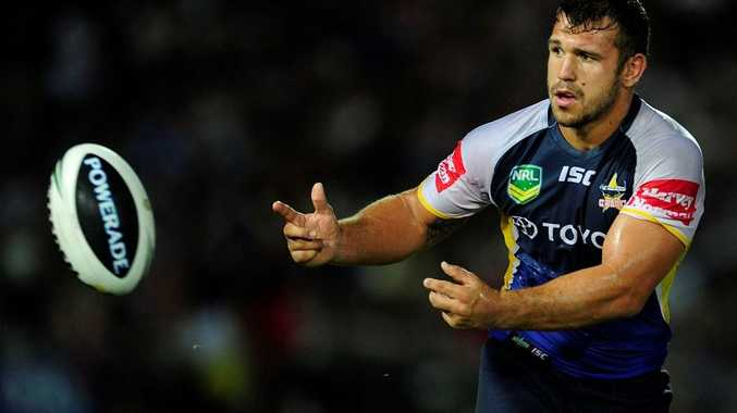 Scott Moore of the Cowboys passes the ball during the round two NRL match between the North Queensland Cowboys and the Melbourne Storm at 1300SMILES Stadium on March 16, 2013 in Townsville, Australia.