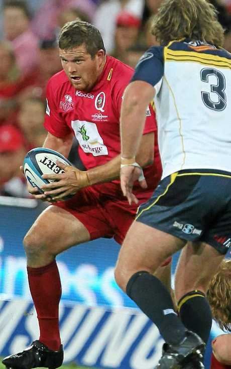 Greg Holmes shows his style for the Queensland Reds in the run-up to his 100th game.