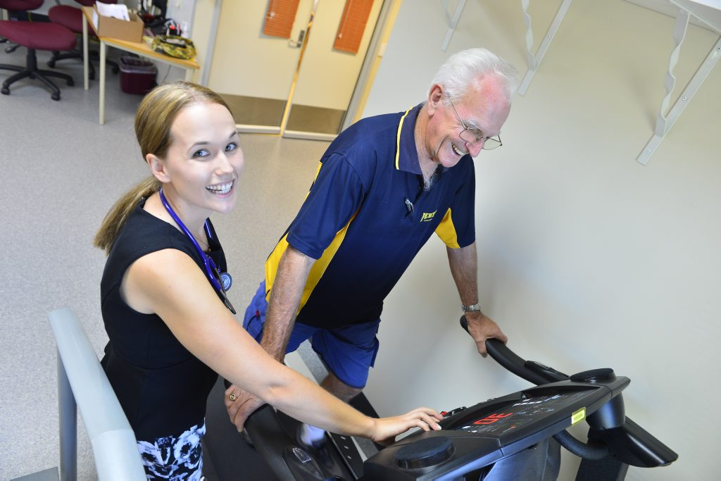 Cardiac Rehab's exercise physiologist Kathryn Kirchner and course participant Les Mayfield.