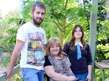 Sam and Corby Small with their mum Sandi Small who has been in a wheelchair since she was 18.