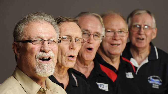 IN FINE VOICE: Jim de Busman puts Kevin Prout, Gordon Dryden, Howard Kennedy and Trevor Remphry from The Miner Chords through their vocal scales ahead of the national titles.
