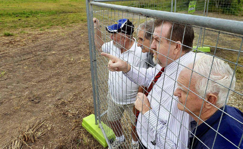 FRONT LINE: Graham Wyeth, Dave Carney and Reg O'Dea meet with Cr Paul Tully near a fire ant infestation off Woogaroo Street.