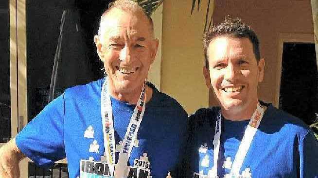 Alan Crawford, left, and his neighbour Robert Bennett celebrate finishing the Port Macquarie Ironman.