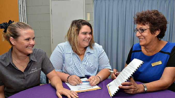 Year 11 Pioneer State High School student Shanae Vick gets advice from Yamadi Home and Community Care Service administrator Tenille Trapp (left) and co-ordinator Elizabeth Warren.