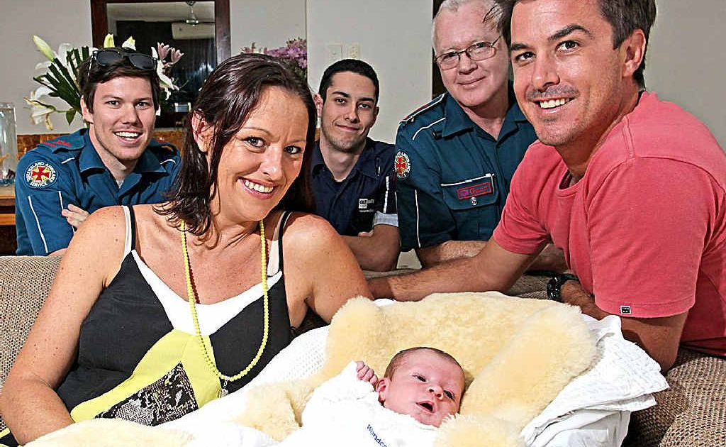 Arlie-Rose King and Matt Pashley thank ambulance officers Sam Bennett, Michael Garrahy and Gary Axsentieff for help with the unexpected home birth of their daughter Milly Rose.