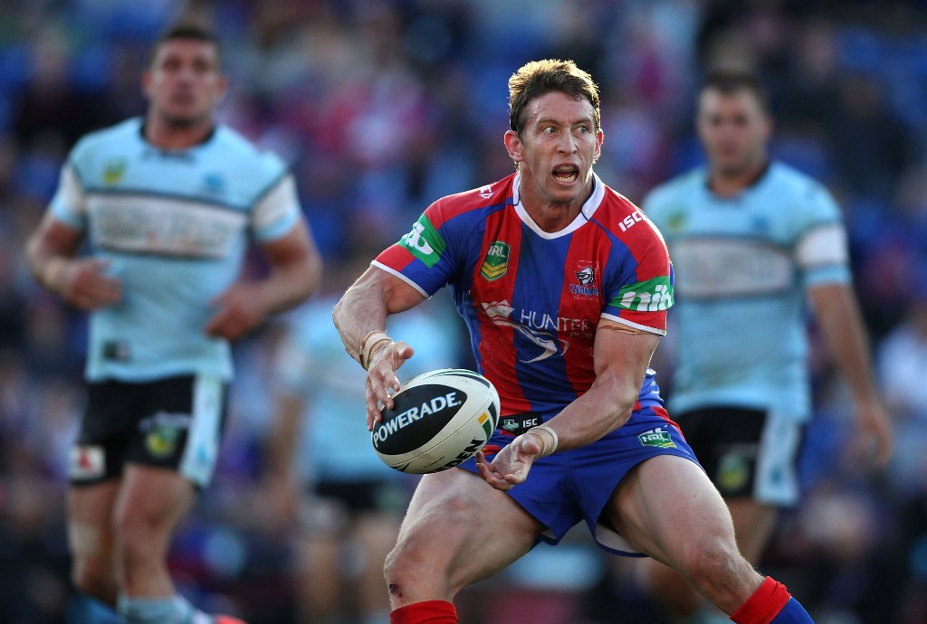Kurt Gidley of the Knights passes the ball during the round eight NRL match between the Newcastle Knights and the Cronulla Sharks at Hunter Stadium on May 5, 2013 in Newcastle, Australia.