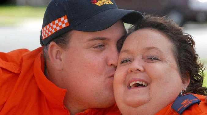 Jeffrey Dunbavan gives his mum, Carol, a Mother's Day kiss.