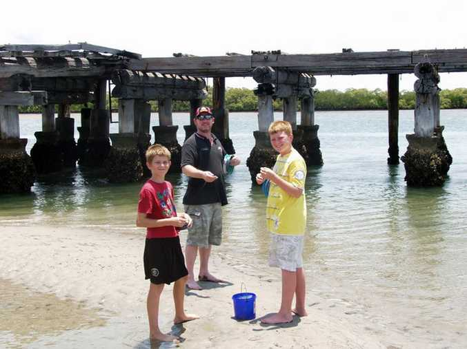 Michael Clifton teaching Michael Boggan and his brother to fish in 2010. Photo: Facebook
