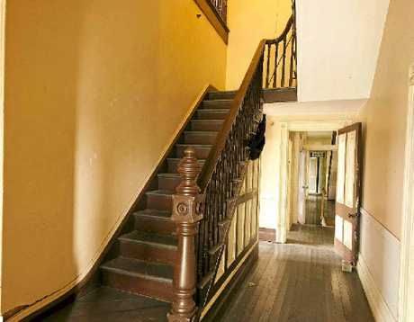 A RED cedar stairway is a classical feature of this Victorian building.
