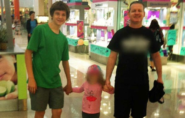SHOPPING TRIP: Michael Boggan with his sister and stepfather Michael Clifton on a Mother's Day shopping trip hours before the bomb blast.
