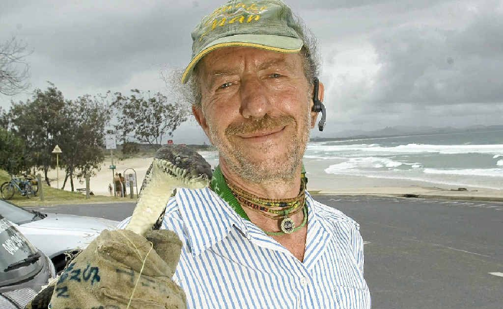 GOTCHA: George Ellis, snake handler, warning Byron Bay residence and holiday makers of the ever present danger of snakes near the Byron Bay pool.