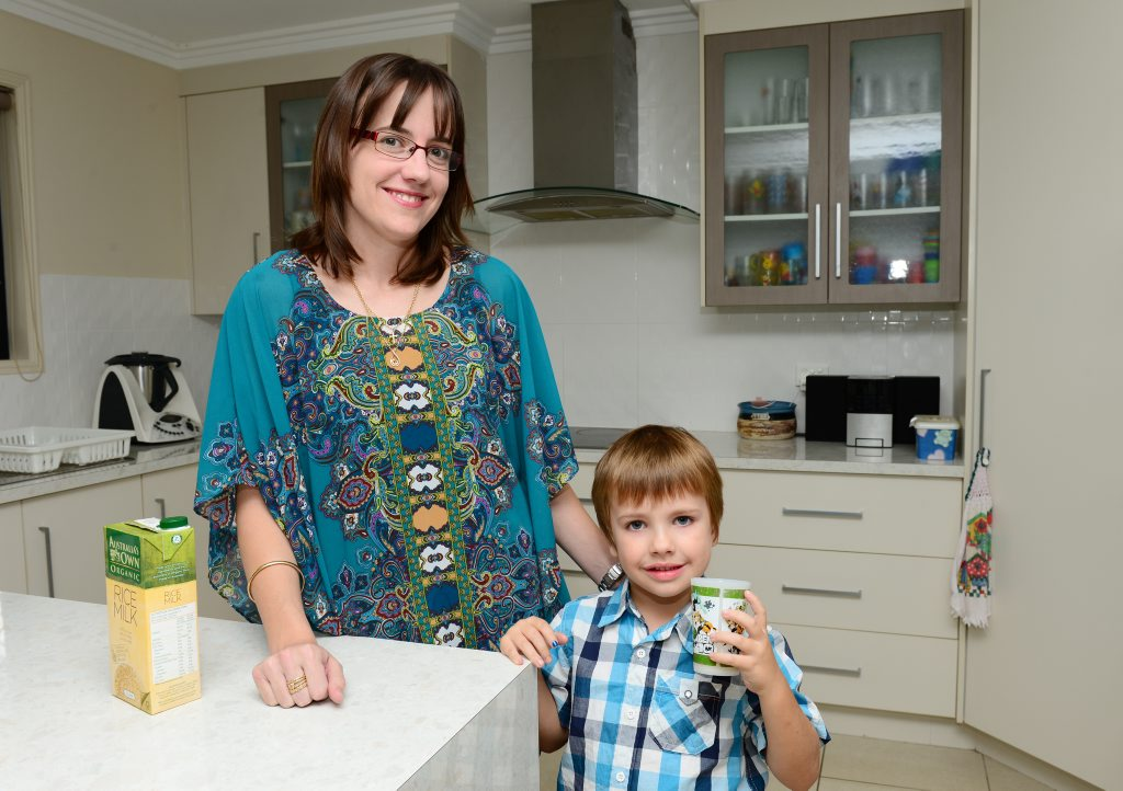 Nicole Bloomfield pours her son Riley some rice milk. Riley is allergic to dairy.