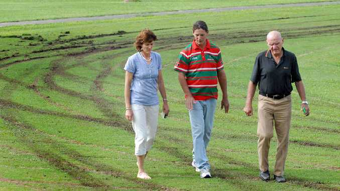 Ruth Cliffe, David Glendinning and Paul Wright inspect the extensive the damage to the Wally O'Grady oval at the Brewers Park Complex, Sarina.
