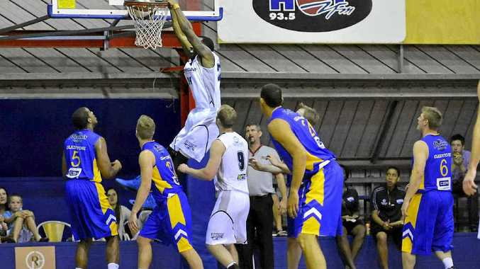 ALL STYLE: Rockhampton Rockets' Justin Watt makes a slam dunk during the match against Phoenix Power at Gladstone's Kev Broome Stadium.