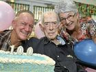 Ex-teacher Tom Richmond celebrates his personal milestone with former students Ken Bizzell and Gail Davis.