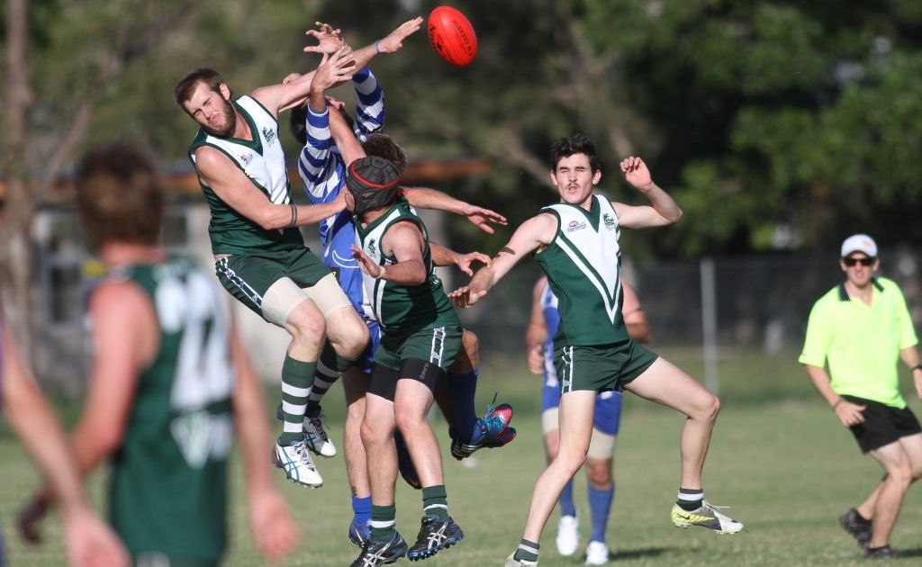 Gladstones Chris Zwar punches the ball clear in the game with Brothers. Photo Allan Reinikka / The Morning Bulletin
