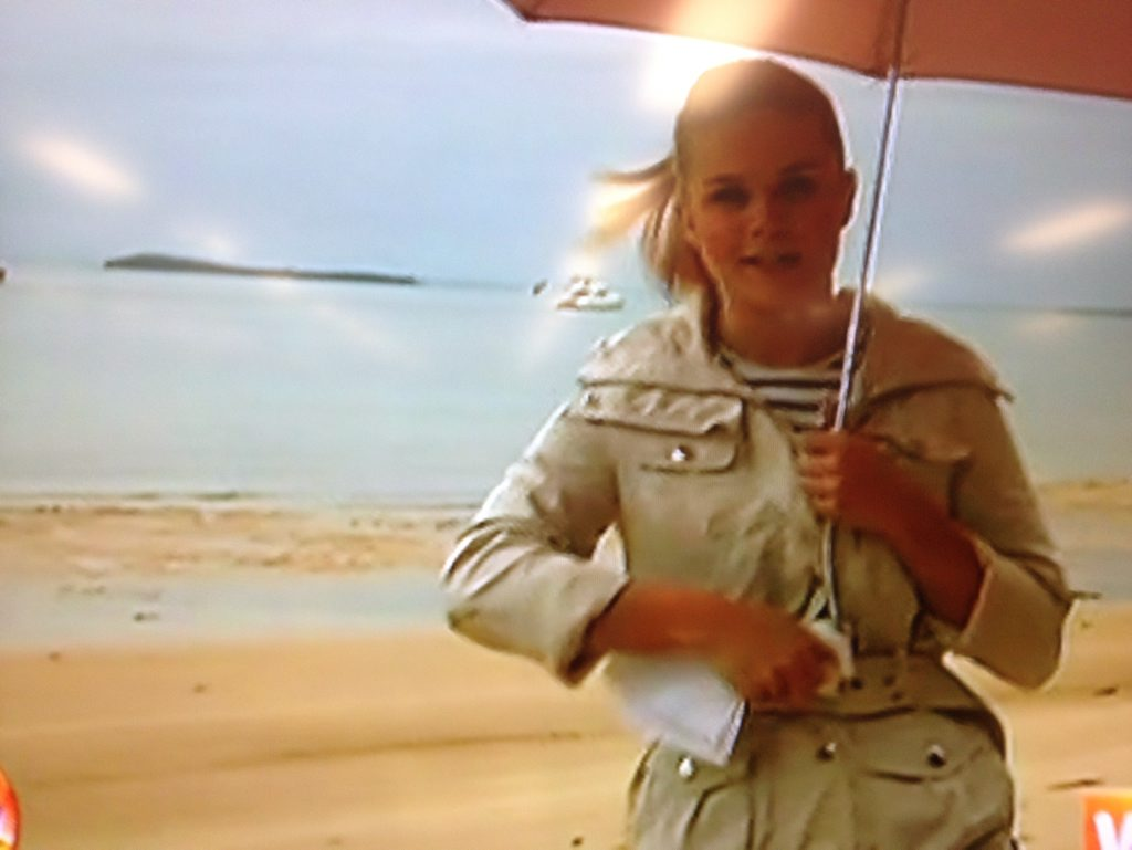 Today show weather presenter Emma Freedman with her clip-on umbrella on Fraser Island.
