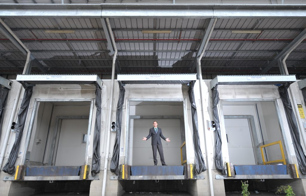 MAJOR SITE: Real estate agent Damian McMahon at the former Jacaranda butter factory in Booval, which is for sale.