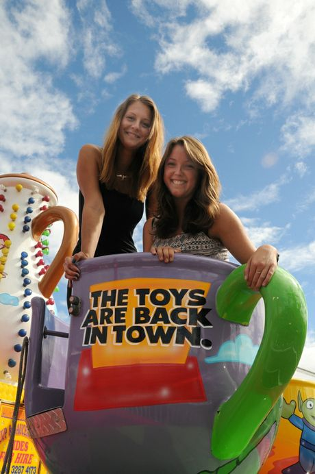 The toys are back in town and Laura Limbrunner and Annie Maier take a break before the real fun starts tomorrow.