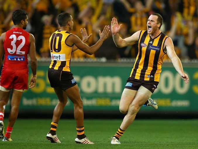 Jarryd Roughead of the Hawks is congratulated by Bradley Hill of the Hawks after kicking a goal during the round seven AFL match between the Hawthorn Hawks and the Sydney Swans at Melbourne Cricket Ground on May 11, 2013 in Melbourne, Australia.