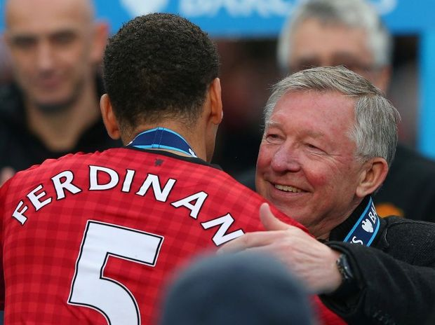 Manchester United Manager Sir Alex Ferguson embraces Rio Ferdinand following the Barclays Premier League match between Manchester United and Swansea City at Old Trafford on May 12, 2013 in Manchester, England.