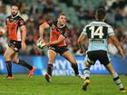 Robbie Farah of the Tigers passes during the round nine NRL match between the Wests Tigers and the Cronulla Sharks at Allianz Stadium on May 10, 2013 in Sydney, Australia.
