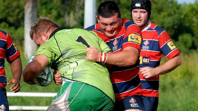 Whitsunday prop Bill Pratt charges into the defence of City's Kane Smith.