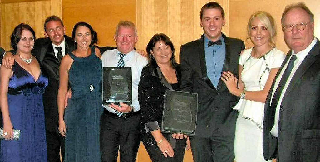 The Shed Company's Tim Churchill (third from right) and employees celebrate their second Dealer of the Year title at a recent national franchisee awards.