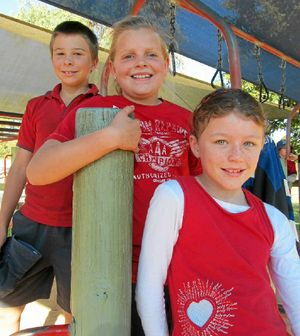Wearing Red for Daniel were (from left) Clifton State Primary School students, Liam Free, Bella Ebneter and Shayne Pointon.