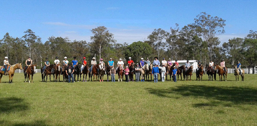 Barrel racers from the three day school line-up before their jackpot race.