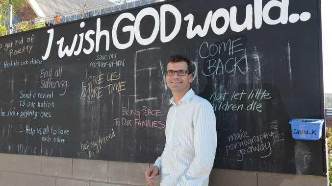 THE WRITTEN WORD: Senior pastor Scott Muir from Central Church Ipswich beside the blackboard.