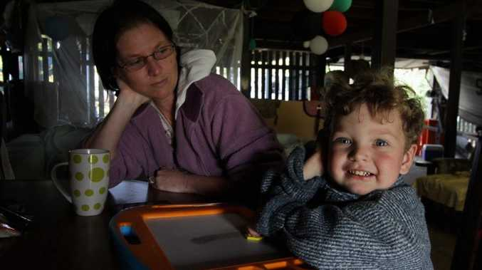 Single mother Leanne Hajduk is at a loss to know how she will make ends meet after the recent Budget cuts. She is pictured with one of her children, Ned Wykes, 3.