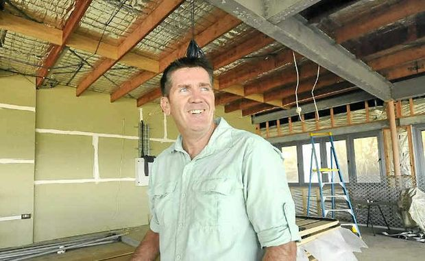 VERY HAPPY: Ballina Lighthouse and Lismore Surf Life Saving Club president Kris Beavis inspects the upstairs function area of the new surf club.