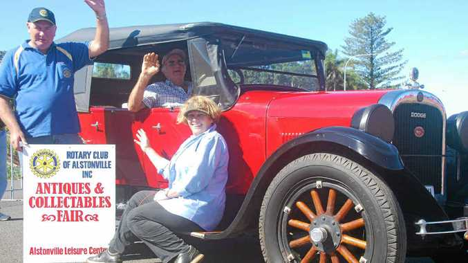 HOT STUFF: Laurie Middleton shows off his vintage Dodge to Alstonville Rotarians Geoff Alexander and Elva Fitzell.