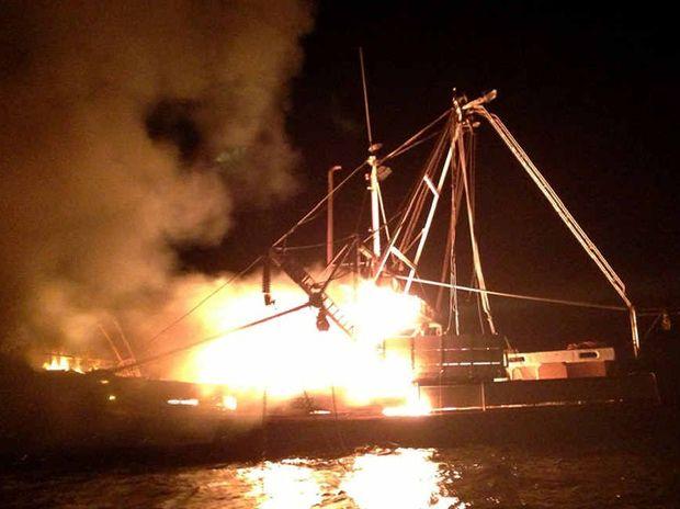 NIGHTMARE: Ballina-registered trawler Jabren, skippered by Tony Puglisi (inset), well alight off Mermaid Beach on Monday night.