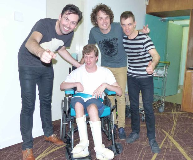 Gladstone's Joel Dennien, who has cerebral palsy, with Peter and John from Evermore.