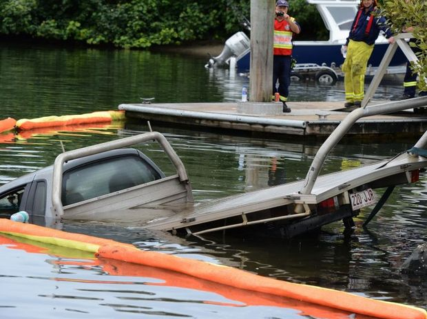 Stolen car in the Tweed river, Fingal boat harbour. Photo: John Gass / Daily News