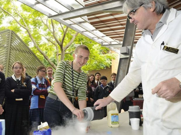 Dr Mark Lynch shows Mt Lofty student Julie Smith how to make ice-cream with liquid nitrogen at the Student Experience Day at USQ yesterday.
