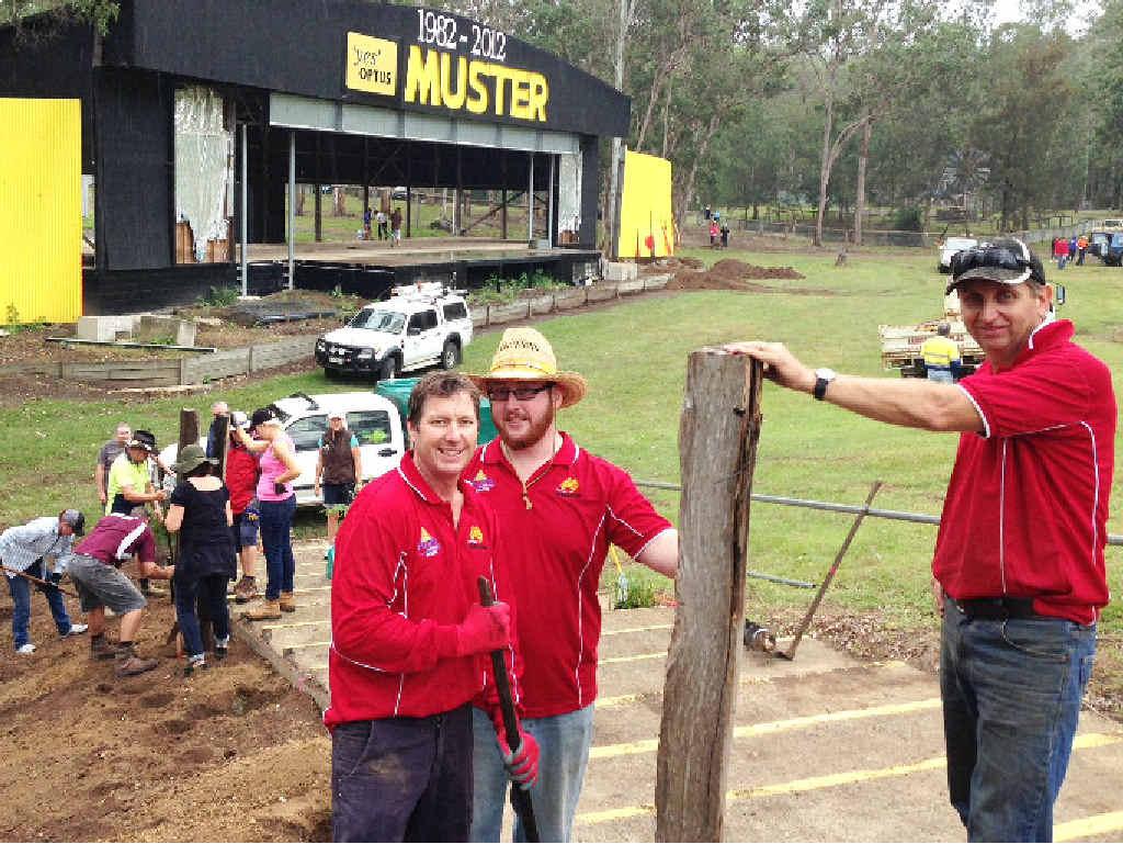Apex members Scott Parkinson, Gene Visini and Peter Bazzan help repair damage at the Muster site from flooding.