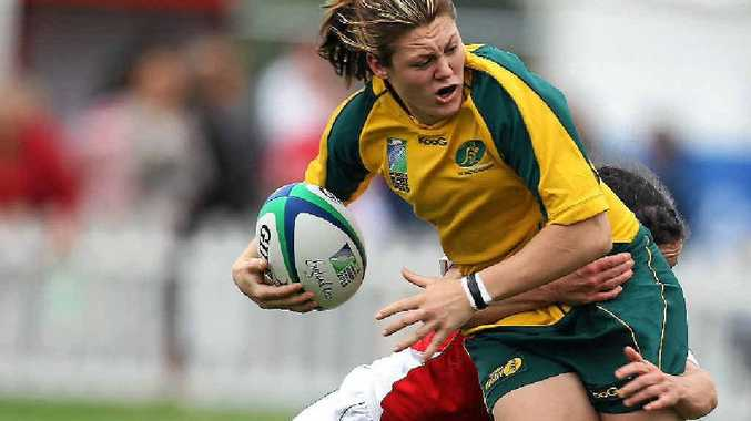 Australian captain Sharni Williams is tackled by Melissa Berry of Wales.