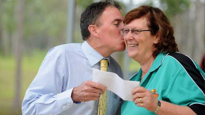 Fraser Coast Mayor Gerard O'Connell is gobsmacked as scout jamboree finance director Jean Clifford hands him a cheque for $30,000.