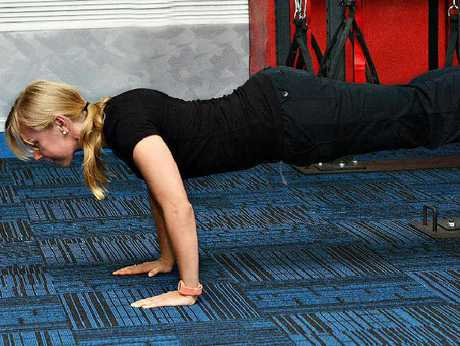 Ashlee Hirst demonstrates Rip 60 push-ups, part of the Tribe Team Training to be launched at City Fitness.