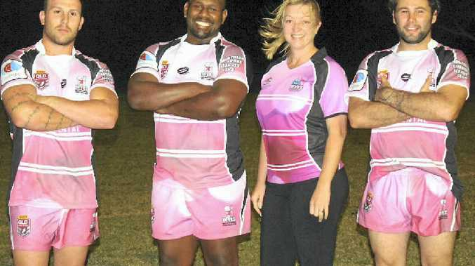 LOOKING GOOD: Norths Devils secretary Danell Curtis wears a ladies polo and players Callum Belsham, Zac Williams and captain Brendan Kelly model the club's special pink strip for tomorrow's Women in League round.
