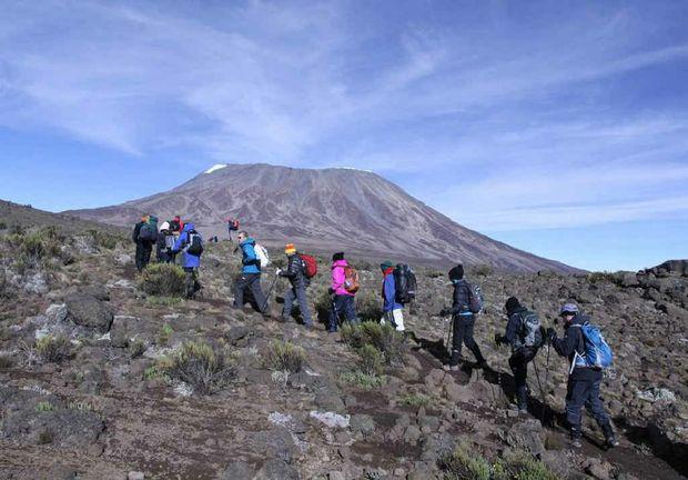 Jessica Beyers and partner Cory Ebenestelli trekking Mt Kilimanjaro.
