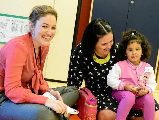 Speech pathologist Rebecca Watson with mum Tara Serrano and daughter Vienna, 2, at Gladstone's Community Health Centre.