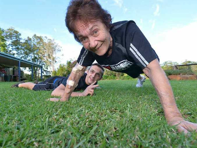 Joan Mullighan stretches at home with support from grandson Max Altinger.