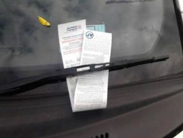 The driver of an Auckland Transport car parked in a disability carpark in Mt Eden will be hit with a $150 fine.