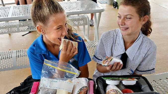 Northern Beaches State High School students Aleesha Spyve (left) and Jazmyn Ridley tuck into their healthy lunches.