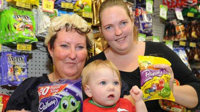 Sally Ingram, Mollie-May Ingram, 1, and Kasey Ingram join the after-school rush at Hatties IGA grocery store.