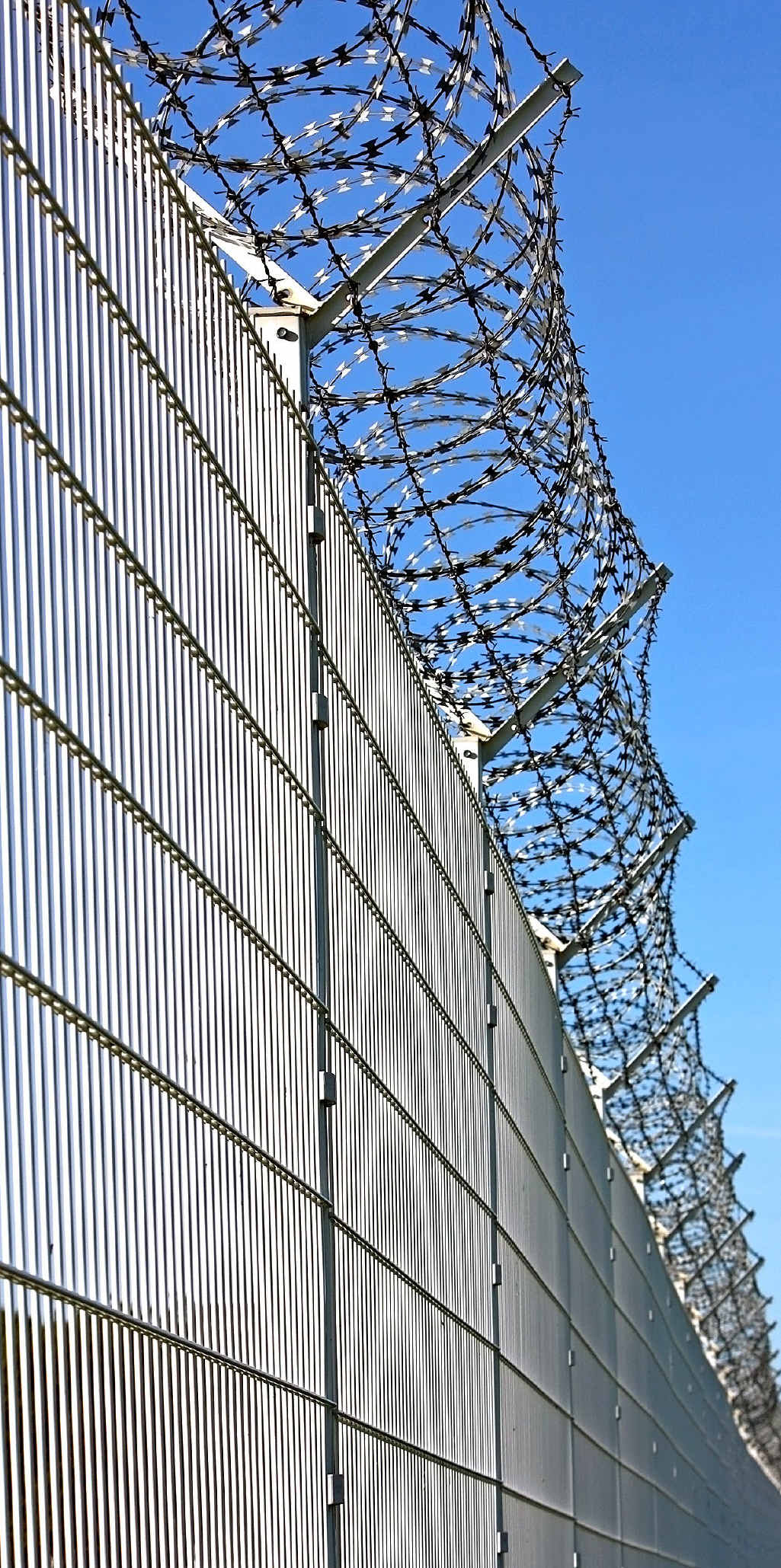 Not even razor wire could stop this young dad from making sure his child was OK.